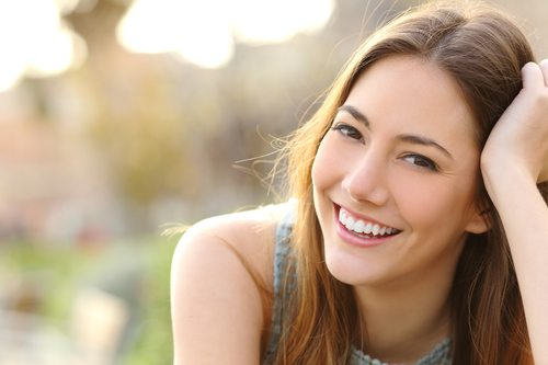 woman smiling with straight white teeth