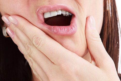 close-up of mouth, woman experiencing tooth pain